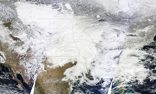 Three images from the Moderate Resolution Imaging Spectroradiometer (MODIS) aboard NASA's Terra satellite were combined to create this image of the storm system. The images were captured on January 31 at 10:30 a.m., 12:05 p.m., and 1:45 p.m. Eastern Time (15:30, 17:05, and 18:45 UTC). Diagonal lines across the image show the boundaries between the overpasses. White gaps are areas where the sensor did not collect data. The image has a resolution of one kilometer per pixel. .Credit: NASA Goddard MODIS Rapid Response Team via CNP