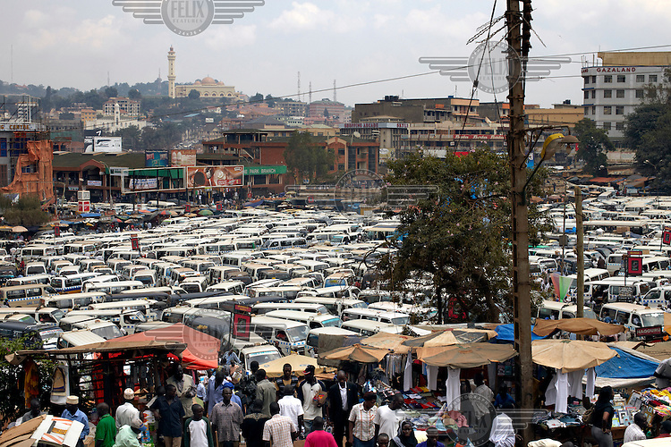A view across a minibus station up towards Kampala Mosque also known as the National Mosque or the Gaddafi National Mosque; as the late dictator paid for its construction.
