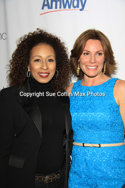 LuAnn de Lesseps Real Housewife of New York and ATWT Tamara Tunie - The 2013 Skating with the Stars- a benefit gala for Figure Skating in Harlem on April 8, 2013 at Trump Wollman Rink, New York City, New York. (Photo by Sue Coflin/Max Photos)