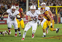 LOS ANGELES, CA - November 16, 2013:  Stanford Cardinal running back Tyler Gaffney (25) during the Stanford Cardinal vs the USC Trojans at Los Angeles Memorial Coliseum in Los Angeles, CA. Final score Stanford Cardinal 17, USC Trojans  20.