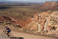 Cyclist Robert Armstrong, of San Antonio, Texas, climbs the 1000-foot Mokee Dugway pass up Cedar Mesa near Mexiacn Hat, Utah, July 1, 2010. The road, cut by uranium miners a half century ago, was the ispiration for Edward Abbey's Monkey Wrench Gang. The Red Rock Canyons Tour, organized by Lizard Head Cycling Tours, wound through 400 miles of the desert southwest. The route traveled through canyons and national monuments in Colorado, Utah and Arizona, ending at Lake Powell. (Kevin Moloney for the New York Times)