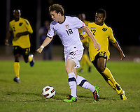 Jack McBean (19) of the United States sprints past Patrick Palmer (12) of Jamaica during the semifinals of the CONCACAF Men's Under 17 Championship at Catherine Hall Stadium in Montego Bay, Jamaica. The United States defeated Jamaica, 2-0.