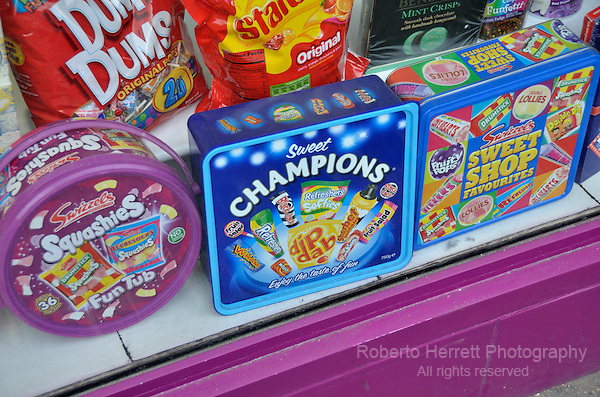 Tins of sweets in a shop window.