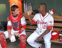 Starting pitcher Manuel Rivera (26) of the Greenville Drive, right, talks with his catcher, Carson Blair (18) in between innings in a game against the Hickory Crawdads on July 1, 2011, at Fluor Field at the West End in Greenville, South Carolina. (Tom Priddy/Four Seam Images)