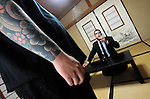 "Jake Adelstein, a former reporter at Japan's largest daily newspaper, Yomiuri Shimbun, and author of Tokyo Vice speaks with his bodyguard, a former yakuza mobster who goes by the name ""Mochizuki,"" at an undisclosed location in Japan on Aug. 29, 2008. In 2005 American Adelstein uncovered a scandal involving senior members of Japan's mafia, the yakuza, visiting a medical center in Los Angeles to undergo liver transplants, despite being bared from entry due to having criminal records or suspected affiliation with Japanese organized crime groups. Within days, however, Adelstein was visited by mob members and told to either ""erase the story or be erased."" He took the former option and resigned from the Yomiuri, though a  leak of his story at one time pushed Adelstein and his family into hiding..Photographer: Robert Gilhooly"