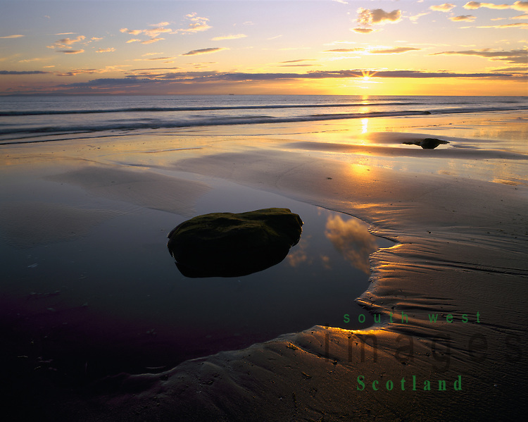 Rock pools on Killantringan beach at sunset looking out to North Channel on Galloway coast Scotland UK