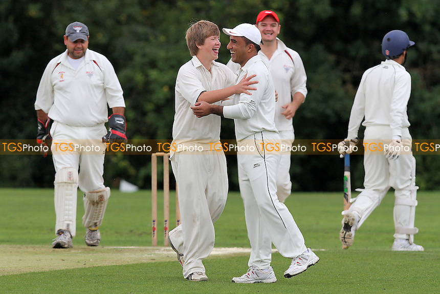 Hornchurch celebrate the wicket of M Qureshi (R) caught off of the bowling of James - Hornchurch CC 4th XI (fielding) vs Gidea Park & Romford CC 4th XI - Essex Cricket League - 27/08/11 - MANDATORY CREDIT: Gavin Ellis/TGSPHOTO - Self billing applies where appropriate - 0845 094 6026 - contact@tgsphoto.co.uk - NO UNPAID USE.