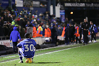 A dejected Oldham Athletic's Temitope Obadeyi sits on the ball after the final whistle in the Sky Bet League 1 match between Oldham Athletic and Bristol Rovers at Boundary Park, Oldham, England on 30 December 2017. Photo by Juel Miah / PRiME Media Images.