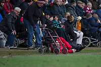 A Cheltenham fan falls off his wheelchair during the Sky Bet League 2 match between Cheltenham Town and Cambridge United at the LCI Stadium, Cheltenham, England on 18 March 2017. Photo by Mark  Hawkins / PRiME Media Images.
