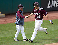 Conor Smith (16) of the Missouri State Bears shakes hands with Head Coach Keith Guttin after hitting a home run during a game against the Northwestern Wildcats at Hammons Field on March 9, 2013 in Springfield, Missouri. (David Welker/Four Seam Images)