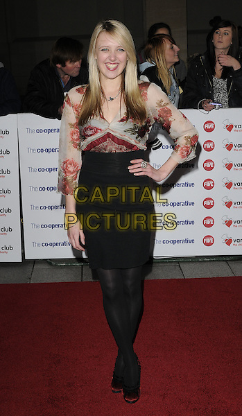 EMILY HEAD.The Co-operative Variety Club Showbiz Awards, Grosvenor House Hotel, Park Lane, London, England, UK, 14th November 2010..full length red print top black high waisted skirt hand on hip tights shoes bows velvet rose floral .CAP/CAN.©Can Nguyen/Capital Pictures.