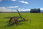 Idaho, Eastern, Tetonia. Vintage farm implements and an old leaning barn in hte Teton Valley of Eastern Idaho.