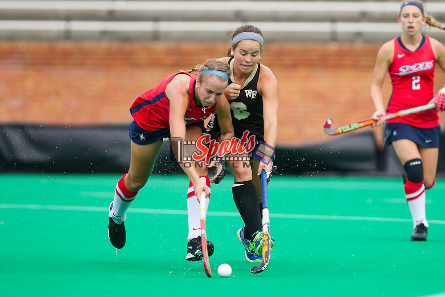 Samantha Ostoich (9) battles for the ball with Kari Walkley (6) of the Wake Forest Demon Deacons in overtime at Kentner Stadium on September 29, 2013 in Winston-Salem, North Carolina.  The Demon Deacons defeated the Spiders 1-0 in overtime.  (Brian Westerholt/Sports On Film)