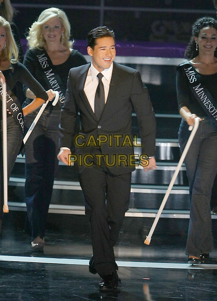 MARIO LOPEZ.Miss America 2009 Show which aired live on TLC held at Planet Hollywood Resort Hotel and Casino, Las Vegas, Nevada, USA..January 24th, 2009.full length black suit .CAP/ADM/MJT.© MJT/AdMedia/Capital Pictures.