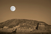 The moon rises over Lake Powel at the Glen Canyon National Recreation Area near Page Arizona