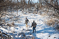 From left, OutdoorLife Editor Andrew McKean (cq) and Web Editor for Ducks Unlimited Chris Jennings (cq) stalk wild turkey during a hunt near Grand Island, Nebraska, Saturday, December 4, 2011. ..Photo by Matt Nager