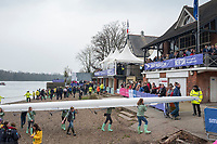 Greater London. United Kingdom,CUWBC, carry their boat of the beach, Cambridge  Women's  BC celebrate winning the  University Boat Race against  Oxford University  Putney to Mortlake,  Championship Course, River Thames, London.  <br /> <br /> Saturday  24.03.18<br /> <br /> [Mandatory Credit:Peter SPURRIER/Intersport Images]