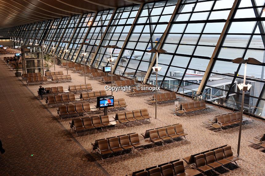 Travelers at a deserted Pudong International Airport, Shanghai, China..