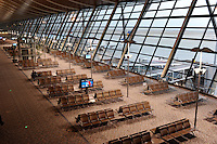 Travelers at a deserted Pudong International Airport, Shanghai, China..