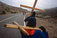 Larry Corona and nephew Patrick Garcia, 12, carry crosses to the Santuário de Chimayó in northern New Mexico on Good Friday. Thousands of pilgrims make a pilgrimage to the 190-year-old shrine every Easter as an expression of faith, a connection to old Hispanic roots and in hopes of the miracles reputed to occur there.