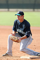 Mickey Wiswall #10 of the Seattle Mariners participates in spring training workouts the Mariners minor league complex on March 19, 2011  in Peoria, Arizona. .Photo by:  Bill Mitchell/Four Seam Images.