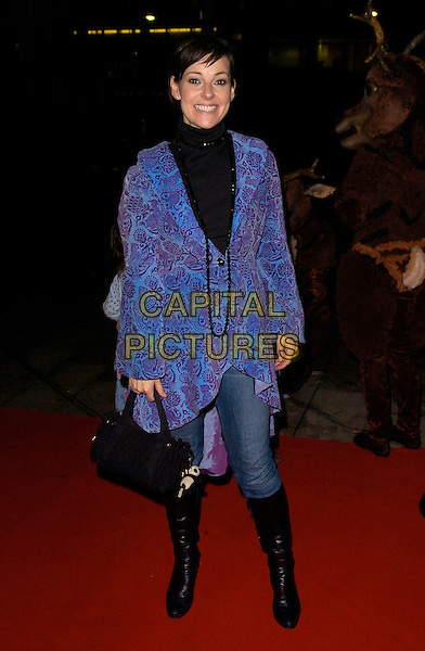 """RUTHIE HENSHALL.""""The Snowman"""" press night, Peacock Theatre, London, England..December 6th, 2007.full length jeans denim tucked into black boots blue paisley purple print pattern necklace top high collar bag purse .CAP/CAN.©Can Nguyen/Capital Pictures"""