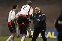 14/01/2006         Copyright Pic: James Stewart.File Name : sct_jspa08_clyde_v_stjohnstone.GRAHAM ROBERTS TRIES TO CUT THOMAS BRIGHTON'S CELEBRATIONS SHORT, REMINDING THEM THAT THEY ARE STILL ONE GOAL DOWN AND TO CONCENTRATE.......Payments to :.James Stewart Photo Agency 19 Carronlea Drive, Falkirk. FK2 8DN      Vat Reg No. 607 6932 25.Office     : +44 (0)1324 570906     .Mobile   : +44 (0)7721 416997.Fax         : +44 (0)1324 570906.E-mail  :  jim@jspa.co.uk.If you require further information then contact Jim Stewart on any of the numbers above.........