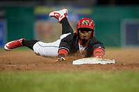 Batavia Muckdogs designated hitter Albert Guaimaro (13) slides into third base during a game against the West Virginia Black Bears on June 18, 2018 at Dwyer Stadium in Batavia, New York.  Batavia defeated West Virginia 9-6.  (Mike Janes/Four Seam Images)