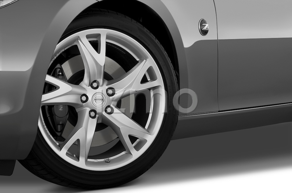 Tire and wheel close up detail view of a 2009 Nissan 370 Z Touring Coupe