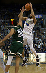 Nevada's Caleb Martin, right, shoot as Colorado State's Deion James defends in the second half of an NCAA college basketball game in Reno, Nev., Sunday, Feb. 25, 2018. (AP Photo/Tom R. Smedes)