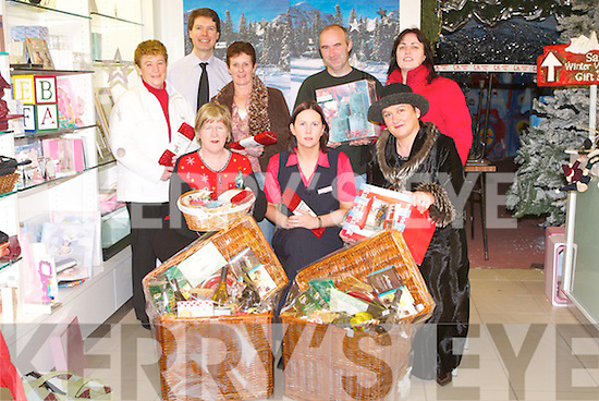 HAMPERS: Collecting their Christmas Hampers on Saturday morning 30 December 2006 in which they won in the Customers free christmas draw at CH Chemists over the Christmas, Front l-r: Mar O'Shea (Tralee), Myra Breen (CH Chemist) and Margaret Brosnan (Scartaglin). Back l-r: Ann O'Mahony (Tralee), Peter Harty (CH Chemist), Kathleen O'Connor (Valentia Island), Michael Keane (Knockanure) and Eleanor Quilter (Lixnaw)..
