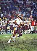 Washington Redskins quarterback Jay Schroeder (10) looks to pass in game action against the San Francisco Forty-Niners at RFK Stadium in Washington, D.C. on Sunday, December 1, 1985.  The Forty-Niners won the game 35 - 8.<br /> Credit: Arnie Sachs / CNP