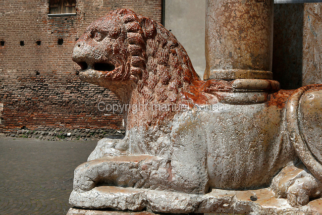 View from the side of one of two lions supporting the columns of the protryon inside the Basilica di San Zeno Maggiore, 10th-14th centuries, Verona, Italy. This Romanesque church which forms the pattern for Verona's Romanesque style was constructed in 967 but damaged by an earthquake in 1117 and restored and enlarged from 1138 to 1398. Picture by Manuel Cohen.