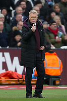 West Ham United Manager David Moyes holds up one finger during the Premier League match between West Ham United and Chelsea at the Olympic Park, London, England on 9 December 2017. Photo by Andy Rowland.