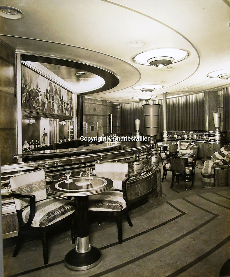 BNPS.co.uk (01202 558833)<br /> Pic: CharlesMiller/BNPS<br /> <br /> Bygone age - The stylish 1st Class Cocktail Bar.<br /> <br /> Photo album documents the birth of the RMS Queen Mary - Britain's glamorous transatlantic flagship from the Golden Age of steam.<br /> <br /> The unique album of photographs were presented to Sir John Stewart, Provost of Glasgow in 1937, and detail the historic construction, launch and fitting out of the famous ship.<br /> <br /> Built by John Brown's on the Clyde the historic ship sailed on her maiden transatlantic voyage on 27 May 1936 and captured the Blue Riband in August of that year.<br /> <br /> The ship became a byword for luxury and glamour on the prestigious route from Southampton to New York, remaining in service until 1967, when she was retired to become a floating hotel in Long Beach, California.