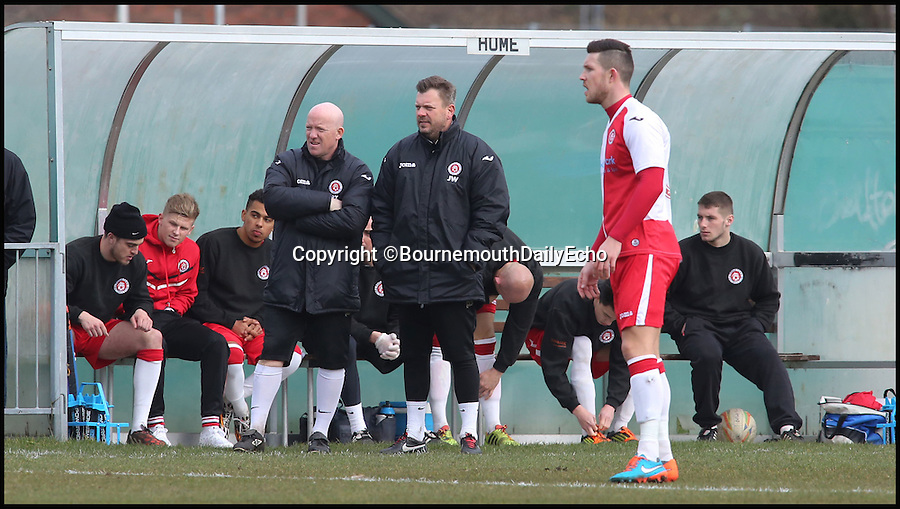 BNPS.co.uk (01202 558833)<br /> Pic: RichardCrease/BNPS<br /> <br /> Assistant manager James Wood took charge from the dugout.<br /> <br /> Poole Town v Cambridge City in the Southern Premier league this weekend. <br /> <br /> Enterprising home boss Tommy Killick watches the game from the attic window of his groundsman's house, after receiving a 6 match ban from the dugout.