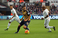 (L-R) Francis Coquelin of Arsenal against Andre Ayew of Swansea during the Barclays Premier League match between Swansea City and Arsenal at the Liberty Stadium, Swansea on October 31st 2015