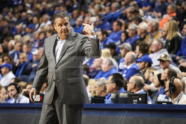 Kentucky head coach John Calipari gestures to his team during the first half of exhibition game between Kentucky and Pikeville at Rupp Arena on Sunday, November 2, 2014 in Lexington, Ky. Photo by Adam Pennavaria | Staff