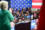 Baltimore, MD - April 10, 2016: Supporters  applaud as 2016 Democratic presidential candidate Hilary Clinton (l) speaks during a campaign event at the City Garage in Baltimore, MD, April 10, 2016.  (Photo by Don Baxter/Media Images International)