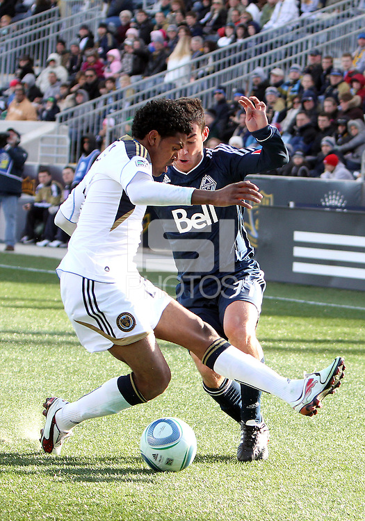 Sheanon Williams#25 of the Philadelphia Union tackles Russell Teibert#31 of the Vancouver Whitecaps during an MLS match at PPL Park in Chester, PA. on March 26 2011. Union won 1-0.