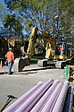 Workers dig a trench while reclaimed water pipes lie in the foreground. The cities of Palo Alto and Mountain View are jointly constructing a reclaimed water pipeline to carry recycled water from the Palo Alto Regional Water Quality Control Plant to customers along East Bayshore Parkway and Mountain View's North Bayshore area.