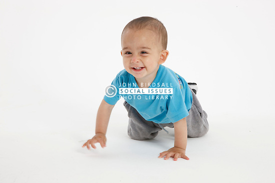 Studio portrait of small asian boy,