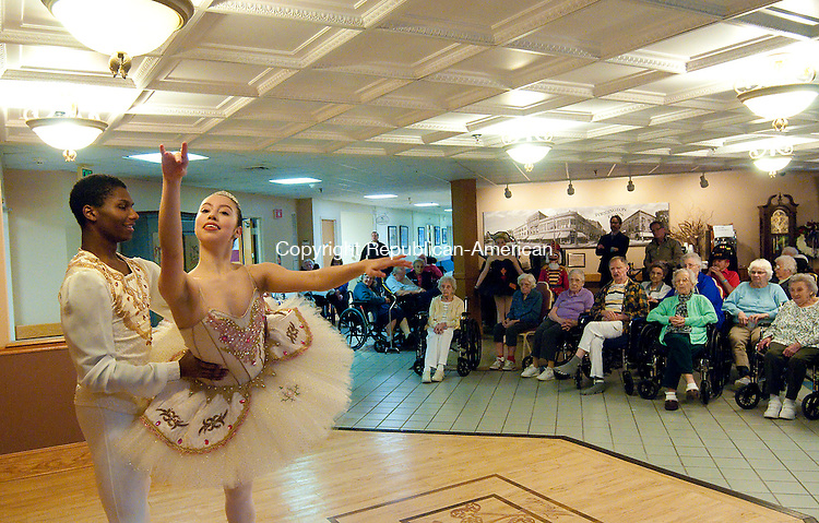 TORRINGTON, CT-112114JS01- Alexandra Lopez and Thel Moore, both dancers from the Nutmeg Ballet's production of The Nutcracker, were part of a group to perform for residents of Litchfield Woods Health Care Center in Torrington on Wednesday. <br />  Jim Shannon Republican-American