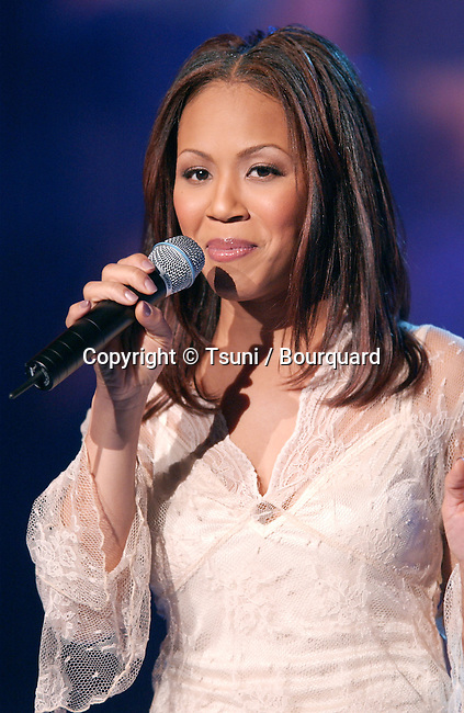 Mary (from Mary Mary) performing at the 2001 Soul Train Christmas Starfest, in Santa Monica Auditorium in Los Angeles. November 20, 2001.          -            Mary_Mary_concert13.jpg