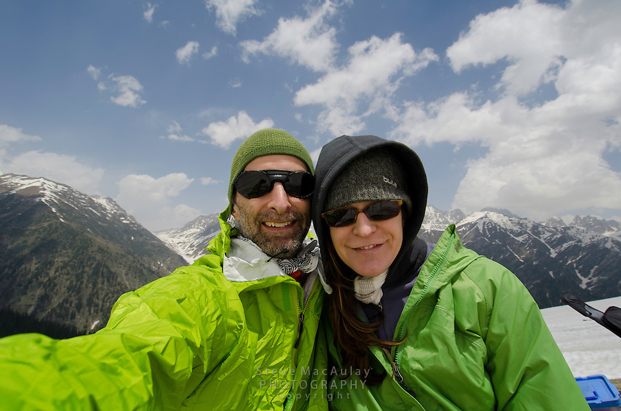 Point of View self portrait of western tourist couple and mountain backdrop, Western Himalayan Mountains, Kashmir, India..