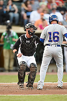 Dayton Dragons catcher Mitch Trees (10) tags Donnie Dewees (16) to complete the strikeout during a game against the South Bend Cubs on May 11, 2016 at Fifth Third Field in Dayton, Ohio.  South Bend defeated Dayton 2-0.  (Mike Janes/Four Seam Images)