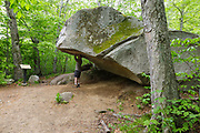 Boise Rock in Franconia Notch State Park of New Hampshire during the spring months. Folklore is that Thomas Boise spent the night under the overhang of this boulder during a blizzard in the 1800's.