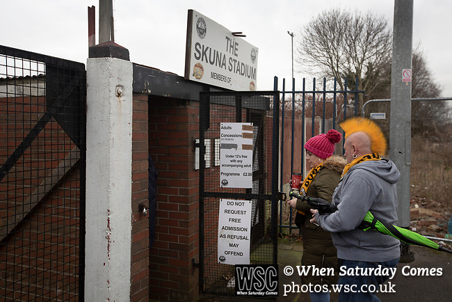 Atherton Collieries 1, Boston United 0, 23/11/19. Alder House, FA Trophy, third qualifying round. Two visiting spectators paying in at the turnstiles before Atherton Collieries played Boston United in the FA Trophy third qualifying round at the Skuna Stadium. The home club were formed in 1916 and having secured three promotions in five season played in the Northern Premier League premier division. This was the furthest they had progressed in the FA Trophy and defeated their rivals from the National League North by 1-0, Mike Brewster scoring a late winner watched by a crowd of 303 spectators. Photo by Colin McPherson.