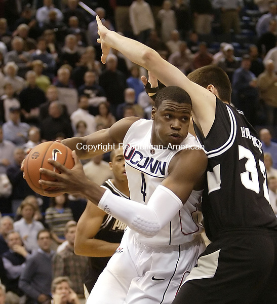 HARTFORD, CT, 01/17/08- 011708BZ03- UConn's Jeff Adrien (4) under the hoop against Providence's Randall Hanke (32) during their game at the XL Center in Hartford Thursday night.<br /> Jamison C. Bazinet Republican-American