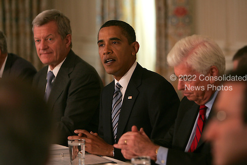 Washington, DC - June 2, 2009 -- United States President Barack Obama meets with Senate Democrats to discuss health care legislation. The meeting was held in the State Dining Room of the White House on Tuesday, June 2, 2009.  Left to right: U.S. Senator Max Baucus, (Democrat of Montana); President Obama, U.S. Senator Christopher Dodd (Democrat of Connecticut)..Credit: Dennis Brack / Pool via CNP